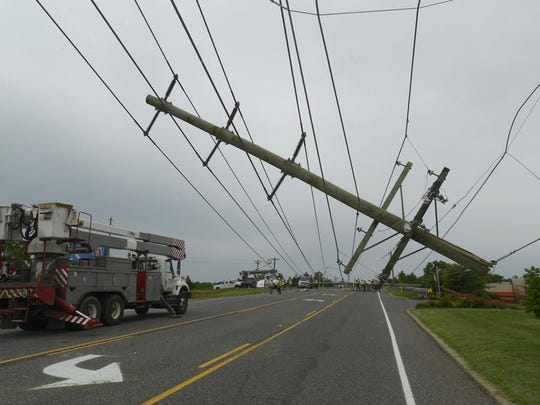 A huge utility pole was toppled in Greenwich during the storms Tuesday.