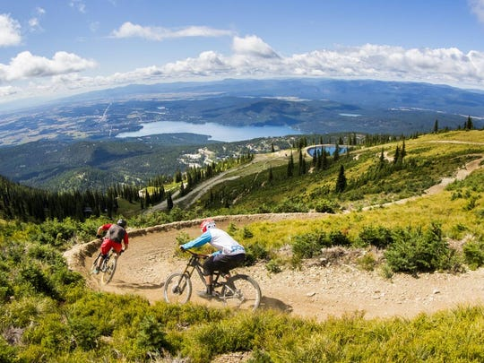 Mountain bikers make their way down a trail at Whitefish Mountain Resort. In recent years, Whitefish has expanded its summer trail system and has about 30 miles of mountain bike trails.