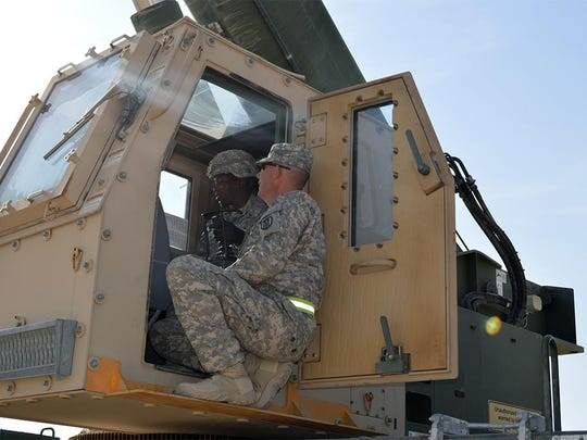 Staff Sgt. Steven A. Loving, assigned to the 961st Engineering Company of Sharonville, Ohio, shows Spc. Chantler R. Phillips, a soldier from Forward Support Company, 528th Engineering Battalion, Monroe, how to operate the Marine All-Terrain Crane.