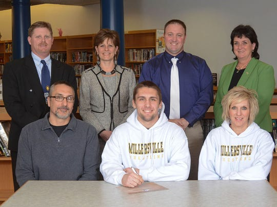 Kyle Narber will wrestle at Millersville Back Row: Roger Czerwinski, AD, Dr. Emilie Lonardi, Superintendent, Brian Gross, coach, Ms. Janet May, Principal Front Row: Dad, Bob Narber, Kyle, Mom Mrs. Richelle Narber (SUBMITTED)