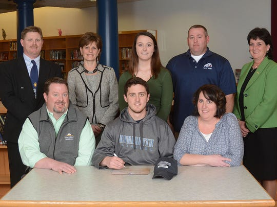 Nick Wilker will play lacrosse at Monmouth University Back Row: Roger Czerwinski, AD, Dr. Emilie Lonardi, Superintendent, Sister, Blake Wilker, Rodney Tamblin, coach, Ms. Janet May, Principal Front Row: Dad, Mr. Nate Wilker, Nick, Mom, Heather Wilker (SUBMITTED)