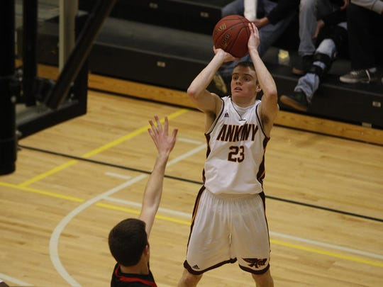 Ankeny guard Conor Riordan's jumper helped the Hawks boys' basketball team get its first win against Ankeny Centennial.