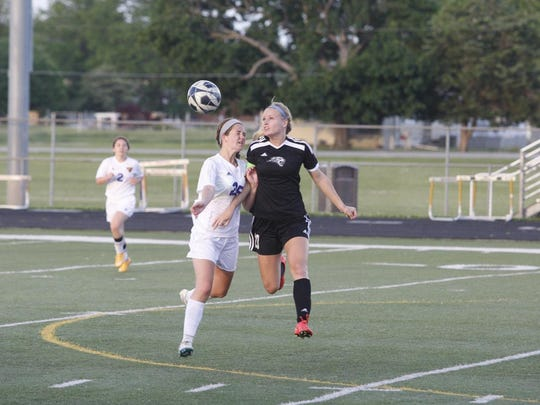 Ankeny Centennial's Meg Brandt heads the ball up the field during the Jaguars' 2-0 victory at Johnston on May 29. Brandt helped the Jaguars to a 14-5 record and was named Iowa's Gatorade player of the year.