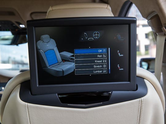 The rear passenger infotainment screen is offered as an option.