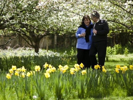"""Ina Garten walks with her husband, who appears often on her TV show """"The Barefoot Contessa."""""""