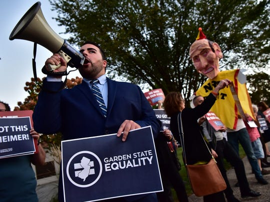 Christian Fuscarino, Executive Director at Garden State Equality, chants at a rally to draw attention to Rep. Scott Garrett's record on LGBT issues in Glen Rock.