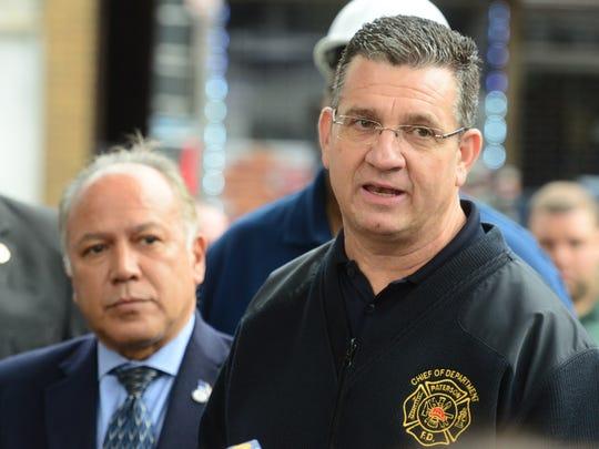Paterson Fire Chief Michael Postorino, right, beside