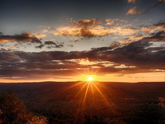 The sun disappears behind the Catskills, as seen from Ellenville in Ulster County.