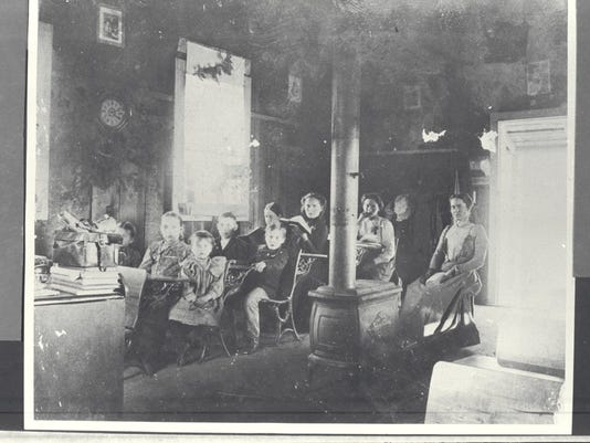 Eight students and their teacher appear in this 1899 photograph inside the Ellis Schoolhouse at Millville. SHS 1974.57.34