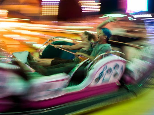 Riders have fun at the Champlain Valley Fair on Wednesday evening August 29, 2018.