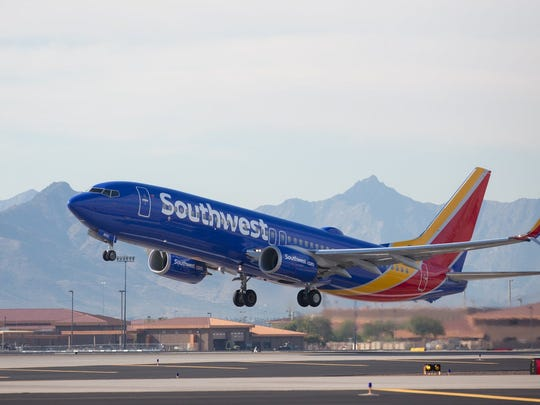 A Southwest Airlines Boeing 737 prepares to land. The carrier is expanding to two new airports, Chicago Midway and Houston Intercontinental.