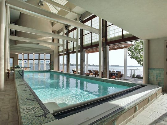 The 40-foot indoor/outdoor pool has heated floors and a glass garage door that opens.