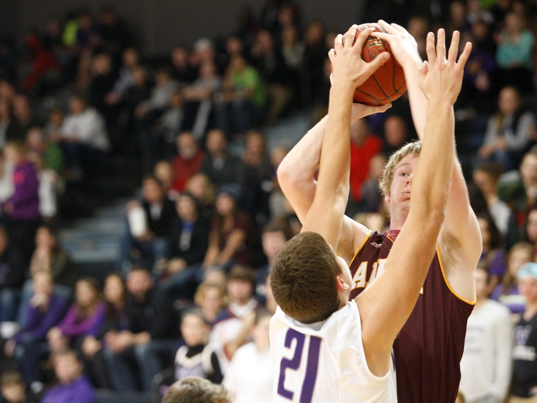 A shot by Ankeny's Joel Roberts is blocked by Waukee defender Anthony Nelson during Friday's game at Waukee. Nelson had eight points, six rebounds and four blocks to help the Warriors to a 67-34 victory.
