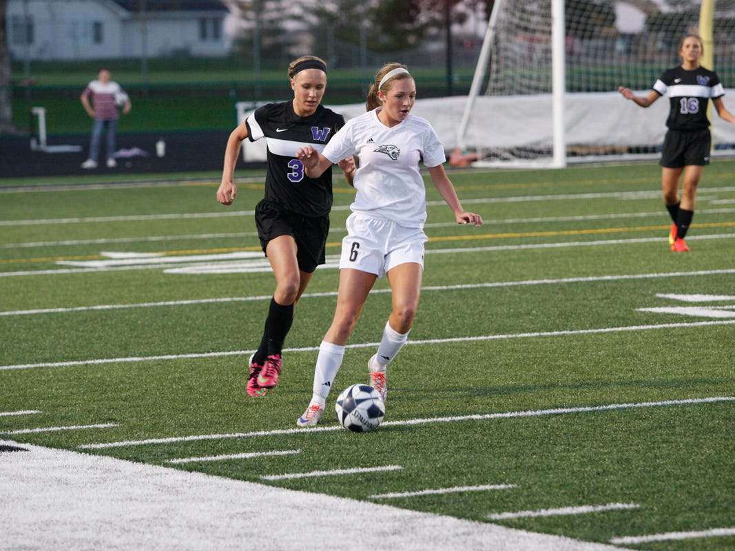 Ankeny Centennial's Kayla Grenier looks to make a pass during a game against visiting Waukee on April 13. The 10th-ranked Jaguars posted a 1-0 victory over the No. 3 Warriors in the CIML Eastern Division opener for both teams.