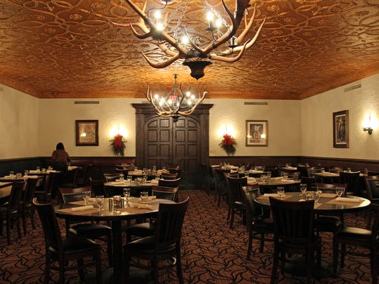 The ceiling and lighting inside the Brown Bottle dining room are vintage Schlitz Brewing Co. décor.