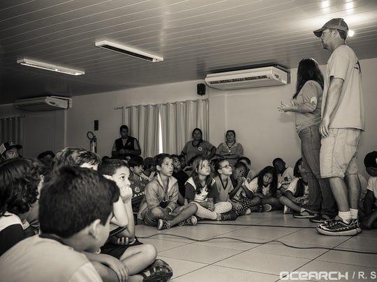 Chris Fischer talks about shark conservation at a Brazilian school.