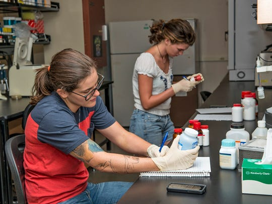 Biology students Laura Jarnagin and Chelsey Mims work in a lab in MTSU's new science building. The $147 million building opened Monday as the university kicked off the fall semester.