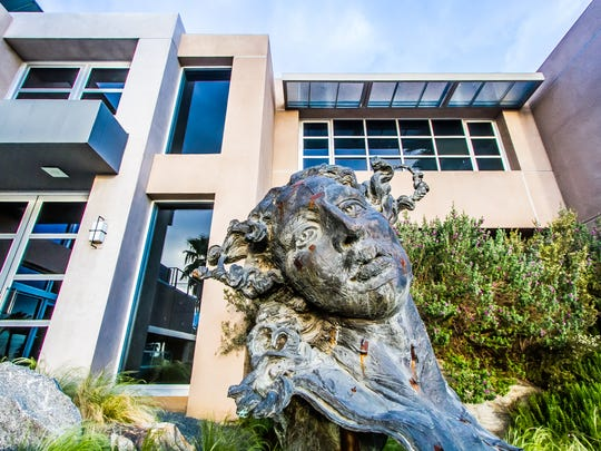 """Visitors to Crestview House are greeted by """"Medusa,"""" a sculpture created by Javier Marin."""