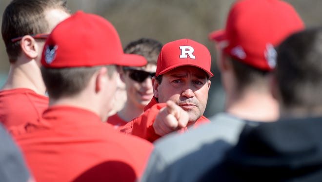 Richmond High School baseball coach Shawn Turner talks to players during practice Tuesday, March 22, 2016 on John Cate Field at McBride Stadium in Richmond.