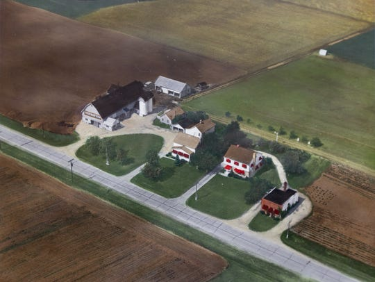 A hand colored aerial photograph of the the Stoer family