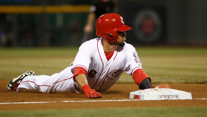 Cincinnati Reds center fielder Billy Hamilton (6) steals third base in the fourth inning against the Chicago Cubs at Great American Ball Park. The Reds won 7-5.