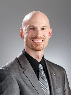 First Ward councilman Adam Jones is leaving council April 12 because he is moving from the city's First Ward to its Fourth Ward.