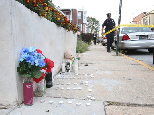 Wilmington police investigate a shooting in the 2600 block of Moore St. reported about 6 p.m. Tuesday. A makeshift memorial from a recent shooting is still in place on West 26th Street near where police were investigating.