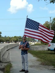 William Servick, a Navy veteran, honors Cpl. Thomas Jardas, 22, of Fort Myers, who died in a Marine helicopter crash in Hawaii.