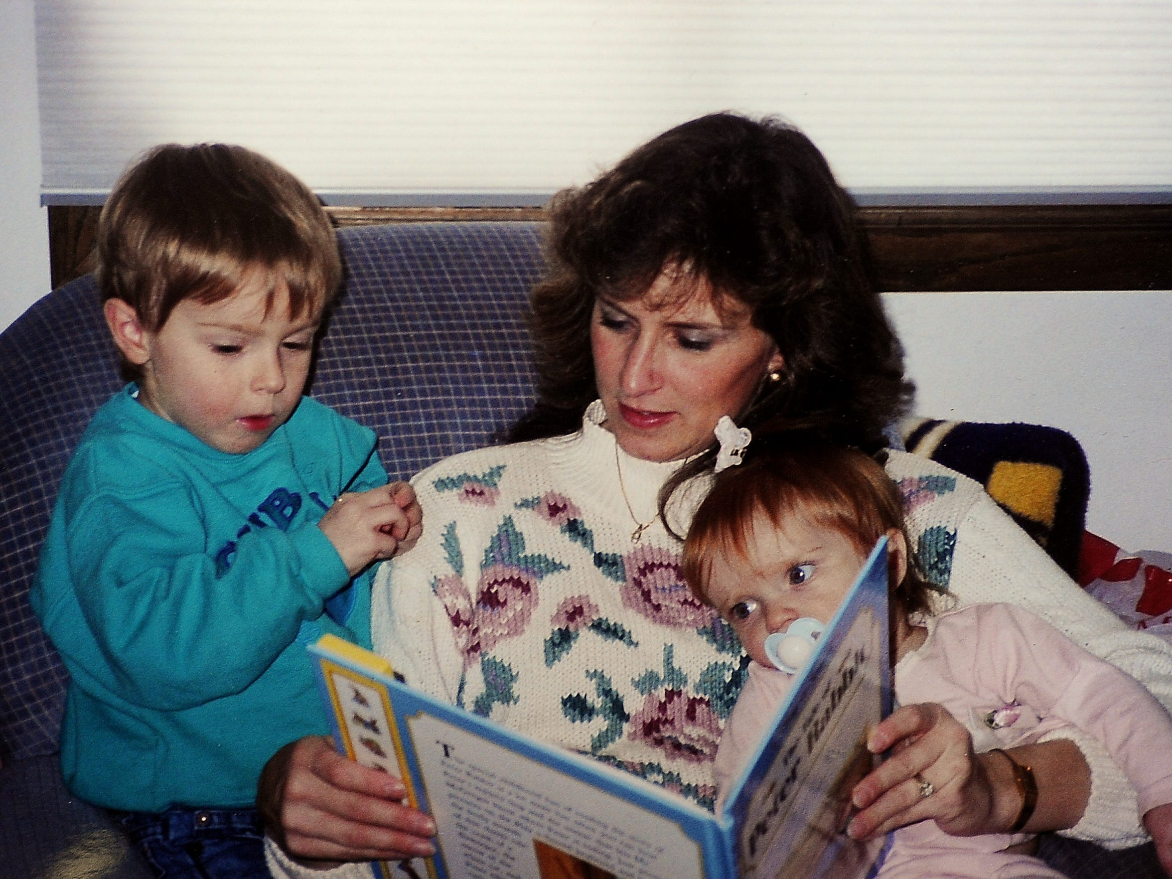 Tami Mielke is seen reading to her children, Austin, left, and Ashley, right, in an undated family photo.