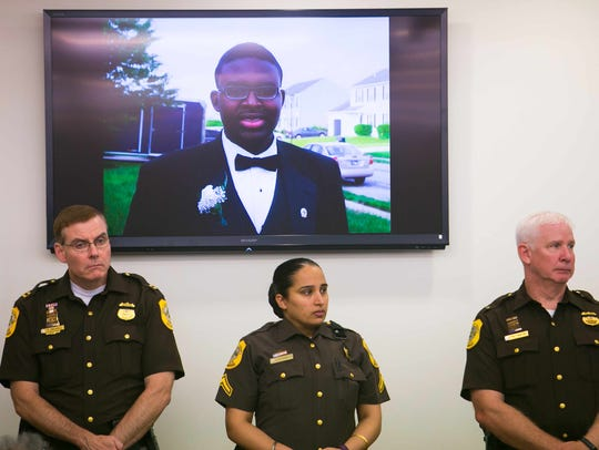 An image of Malcolm Evans, who was killed July 2016. is shown on a screen at New Castle County police headquarters in Minquadale during a press conference in which authorities asked for help solving the killing. He was 19.