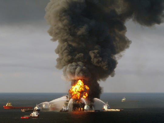 U.S. Coast Guard crews fight the flames on the BP-operated