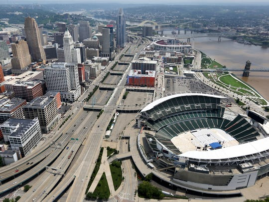 Hamilton County owns Paul Brown Stadium, foreground, and Great American Ball Park, background.  County property owners will pay more in 2018 for the two riverfront stadiums, officials said.  Liz Dufour/The Enquirer A view of downtown Cincinnati along the Ohio River. The Bengals Paul Brown Stadium is in the foreground and Great American Ballpark in the background.