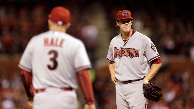 Arizona Diamondbacks starting pitcher Archie Bradley, right, waits on the mound to be removed by manager Chip Hale during the fourth inning of a baseball game against the St. Louis Cardinals on Tuesday, May 26, 2015, in St. Louis.