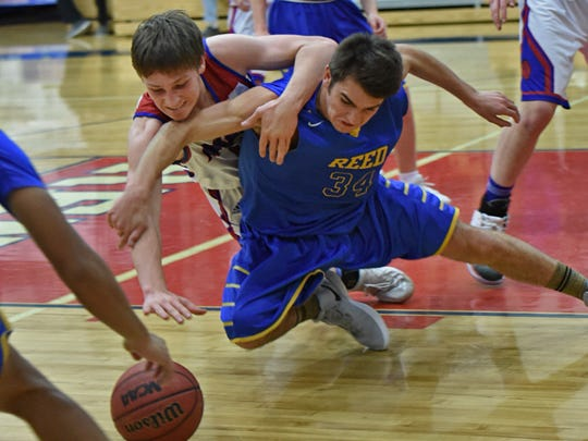 Reno's Luke Stovak, left, and Reed's Tyler Verdi go after a loose ball during Tuesday's game at Reno.