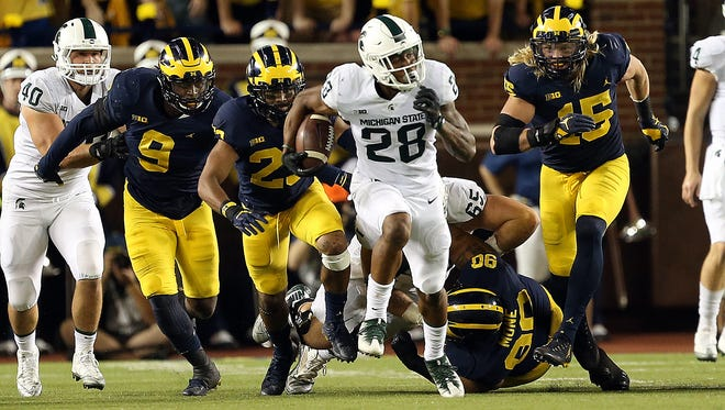 Michigan State running back Madre London takes off for a 50-yard gain in the first half Saturday night at Michigan.