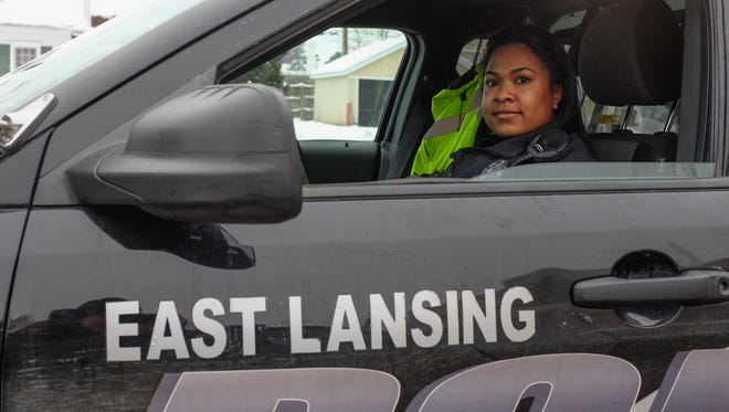 East Lansing police officer Chelsea Morehead gets some work done in her cruiser Sunday, Dec. 17, 2017.