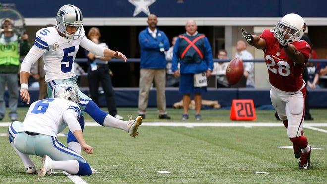 Arizona Cardinals cornerback Justin Bethel (28) blocks a field goal attempt by Dallas Cowboys kicker Dan Bailey (5) during the first half of an NFL football game Sunday, Nov. 2, 2014, in Arlington, Texas.