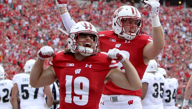 Leo Musso, front, had a 66-yard fumble return for a TD against Michigan State. T.J. Watt leads Wisconsin with 4.5 sacks.
