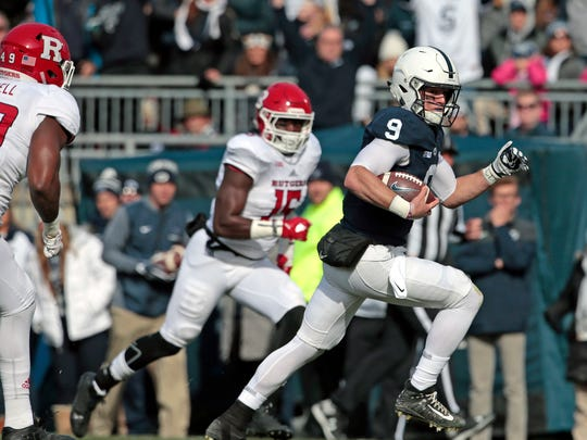 Penn State quarterback Trace McSorley (9) runs in for a touchdown against Rutgers during the first half of an NCAA college football game in State College, Pa., Saturday, Nov. 11, 2017. (AP Photo/Chris Knight)