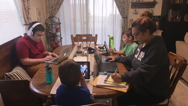 Heather Dorries works alongside her three children in their Palm Coast home. They each have disabilities that earn them special services from their schools -- but when school is the dining room table, it feels near impossible for her to keep up with everything.