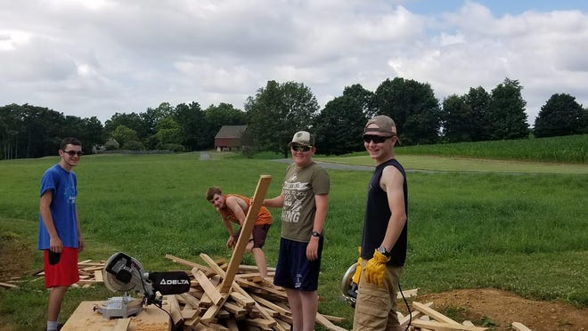Eagle Scout candidate Dominick Ban, left and a few of his friends are pictured here at Renfrew working on the Summer Kitchen Garden project. PROVIDED PHOTO