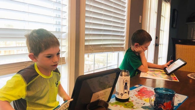 Logan Bitman, 8, and Duncan Bitman, 7, use their iPads for remote learning during their spring semester at Forest Trail Elementary. The Eanes district closed all campuses after spring break this year amid coronavirus concerns. The boys' parents decided to continue remote education in the fall.