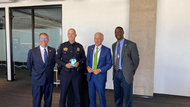 From left to right: State. Sen. Charles Perry, Lubbock police detective Kyle Purdue, Mayor Dan Pope and police Chief Floyd Mitchell gather after Purdue received the South Plains Coalition for Child Abuse Prevention's Cherish the Children award Tuesday during a ceremony at Citizen's Tower.