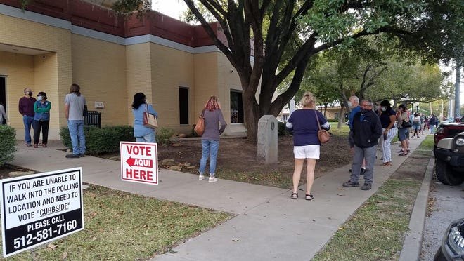 Voters line up at the Bastrop County Courthouse to vote on Tuesday, Oct. 13, 2020, the first day of early voting for the Nov. 3 general election.