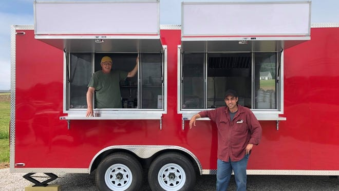 John Almeida Mello IV, owner of Almeida's Vegetable Patch, at right, and Carl Bernier are gearing up to welcome customers to the new Almeida's Earth Bar. The food truck, tentatively slated to open June 20, will be managed by Bernier.
