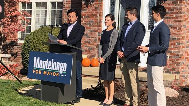 At-Large Councilman Jim Montelongo announces his intent to run for mayor of Peoria on Friday on the front walk of his house along with his wife, Kristina, and sons, Miguel, 21, and Alex, 25. His other son, Jimmy, was unable to attend the morning news conference.