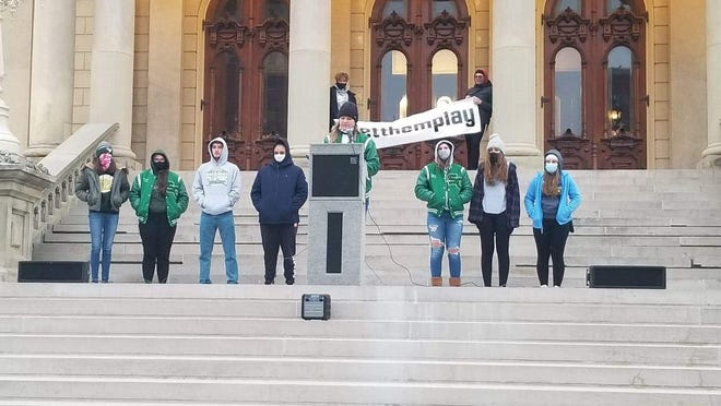 Kindell Covey of Sand Creek speaks to a rally of people in Lansing on Friday.