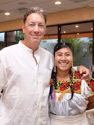 Project manager David Gonzalez with one of the East Valley performers, Alma Ochoa.
