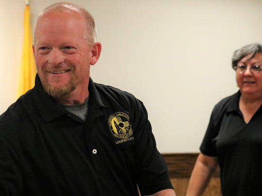 Jerrett Perry smiles as he is congratulated by the Alamogordo Public Schools board Wednesday night.