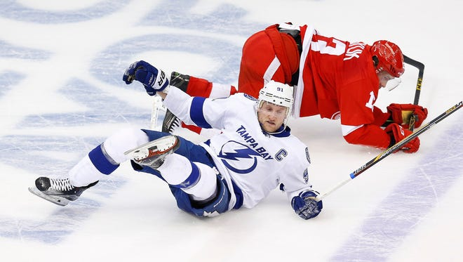 Tampa Bay Lightning center Steven Stamkos and Detroit Red Wings center Pavel Datsyuk collide during the third period of Game 3 of the first-round playoff series in Detroit on April 21, 2015. Stamkos is scoreless through the first five games of the series.